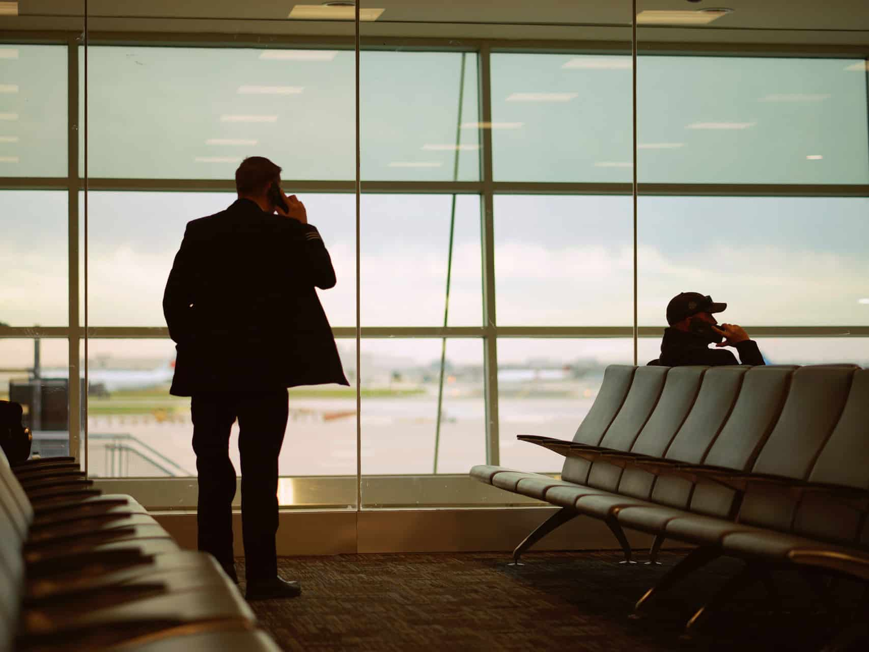 Man In Airport Waiting For Corporate Event Travel